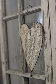 idea for old windows = this and butterflies etc. hanging from the odd pane, with pictures of family in others.
