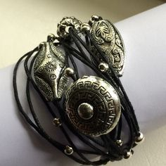 Ladies multi strand bracelet in black leather with silver coloured beads.  Approx. 7 inch long.  Priced at $15 with free shipping via registered post within Singapore only.