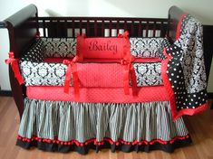 Red & Black Damask Baby Bedding  Included in this set is the bumper, blanket, and crib skirt.  There is lots of detail in this custom set including  soft red minky, red grosgrain ribbons, black and white stripes, polka dots, and damask.