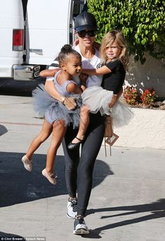 She's got her hands full! Kourtney Kardashian took North and Penelope to dance class on We...