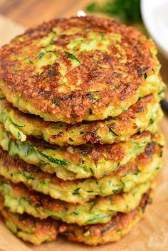 Zucchini Fritters made with fresh zucchini, Parmesan cheese, and a some Mozzarella cheese for an extra cheesy bite. It's pan fried to be crispy in the outside and soft on the inside. Zuchinni Fritters, Zucchini Crisps, Zucchini Parmesan, Zucchini Bread Recipes, Vegetable Recipes, Vegetarian Recipes, Cooking Recipes, Healthy Recipes, Healthy Cooking
