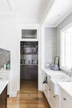 Grey Subway Tile with white grout and white cabinets and sink. The overall space is white and bright and very lovely!
