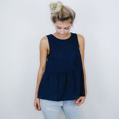 "• Navy blue babydoll style top • Available in S, M, L. Aspyn is 5' 4"" and wearing a size small • 80% polyester, 20% cotton"