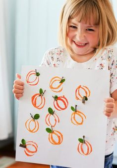 Kids Crafts - Pumpkin Paintings using recycled toilet roll stamps