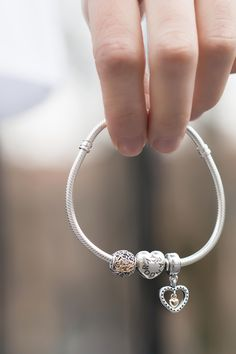 "Beautiful hearts to show your love for a special someone. PANDORA's bracelet with the heart-shaped lock and these two-tone charms are some favorites of male blogger ""One Dapper Street"". #PANDORA #PANDORAbracelet 