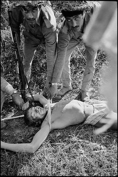 Abbas Attar  Pakistani troops are dishonouring a dead Indian soldier who was killed in battle, near Thakurgaon, East Pakistan, 1971.