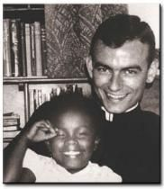 Daniels was the 26-year-old Episcopal seminarian who answered the call of the Rev. Dr. Martin Luther King Jr. to help register African-American voters in Alabama, only to be shot and killed months later, on August 20, 1965, while shielding a then 16-year-old Ruby Sales from the shotgun fired as she attempted to enter a store to buy something to drink. Image: Jonathan with a member of the family he stayed with during his time in Selma, 1965.