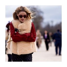 Now this is how to style out freezing temperatures: swathe yourself in shearling like #OliviaPalermo.  Shop shearling at #NETAPORTER #PFW #StreetStyle  Photographed by @theurbanspotter