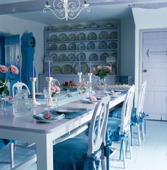 Blue and white china, a blue grandfather clock and blue cushions on the Swedish-style dining chairs punctuate this lilac-painted kitchen