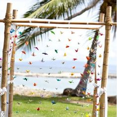 Non-traditional Altars - We could not get over the origami altar this couple had for their beach wedding. A colourful collection of paper cranes hung from a cane arch and moved with the sea breeze.