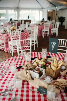 Edible centerpieces and chalkboard style signage for placecards and table numbers.