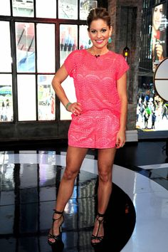 Candace Bure Cameron has toned legs in a pink jumper and strappy high heels on VH1