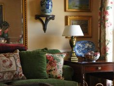 Mossy green velvet couch, blue and white porcelain, buttery walls, oil landscapes, chintz draperies and pillows - divine! - KEK Interiors Inc