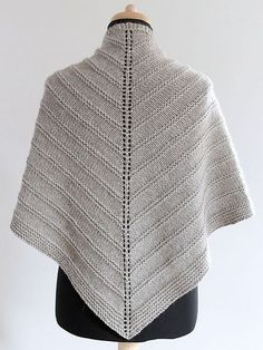 Free Pattern: Skoosh by Amanda Clark. A triangular shaped shawl, worked in one piece, from the top down. by Carmen Perry