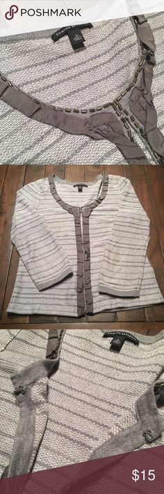 Banana Republic grey frill cardigan Banana Republic grey striped frill cardigan - Size Medium. Only worn a handful of times - in great condition! 3/4 length sleeves. 85% Pima cotton, 15% merino wool (exclusive of decoration). Front fabric clasp closure. Smoke-free home 😊 Banana Republic Sweaters Cardigans