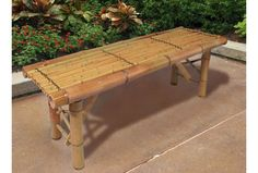 http://www.igreenspot.com/enjoy-a-tiki-inspired-landscape-design-with-your-new-tiki-bamboo-bench-tropical-coffee-table-patio-bar-bench/