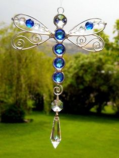 Try a dragon as a window hang with crystals. Dawn Christmas Sapphire Stained Glass Dragonfly Suncatcher by tabu-sam Stained Glass Projects, Stained Glass Patterns, Stained Glass Art, Beaded Dragonfly, Dragonfly Art, Dragonfly Tattoo, Wire Crafts, Jewelry Crafts, Wire Wrapped Jewelry