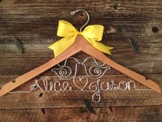Bridal Hanger by GetHungUp, $36.00 Mary <3 Andrew or Mrs. Jones? White hanger with date burned in at top, yellow ribbon, and turquoise wire = perfect! <3