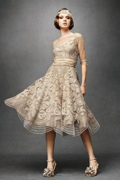Tulle Era Dress $2,600 by Tracy Reese : Swarovski-dotted, floral-appliqued and beaded by hand, with jeweled buttons dotting the V-back and three-quarter sleeves, this bygone-era frock features a ruched band of silk taffeta at the waist and a voluminous, below-the-knee scalloped skirt. Button closure. Nylon tulle; silk slip with adjustable straps; nylon tulle and nylon horsehair hemline for soft shape.  #fashion #dress #1920s