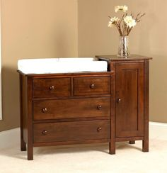 Our Peaceful Dreams Hi-Lo Changing Table in Brown Maple with Winter Bark. The…
