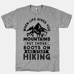 """Get ready to go on a adventure because whenever life gives you mountains it's a great opportunity to go hiking. For those filled with wanderlust who love nature, camping, and exploring the outdoors there is this design that says """"When Life Give you Mountains Put Those Boots On And Start Hiking""""."""