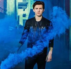 He emerges from the blue smoke like a model- wait, he's not a model??