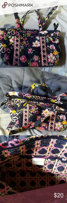 Purse Navy blue with white, purple and pink flowers. Very small pocket on outside of purse , on the inside there is a total of 6 pockets, 3 on each side. The purse zips. Great condition, barely used. Vera Bradley Other
