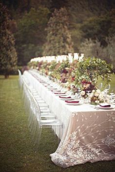 TableScapes for Italian Theme: White & Plum Flowers.