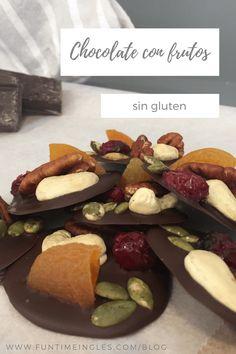 Círculos de chocolate con frutos secos y frutas deshidratadas, sin gluten. Muy sencillos de preparar con los niños, son un regalo muy original. #singluten #chocolate #cocinaconniños