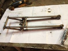 The classic girder fork takes shape.
