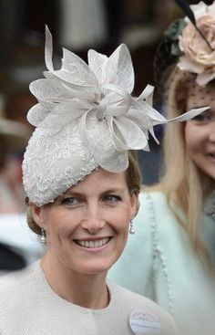 The Countess of Wessex topped off her taupe suit with a stunning bow-trimmed Jane Taylor hat.