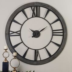 """At 60"""" the Ronan clock will take up a lot of wall space and become the center of attention. Design the room with this hung on the wall fist. http://www.clocksaroundtheworld.com/uttermost-clocks.html"""