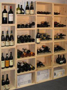 Casiers bouteilles, casier vin, rangement du vin, aménagement cave, casier bois, cave à vin, meuble vin. Installation de notre gamme Stapel dans une boutique.