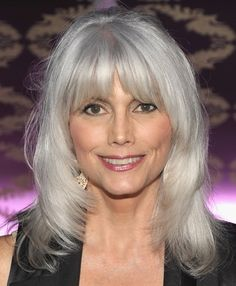 Pretty layers and a rich silver color give Emmylou Harris' long gray hair a distinctive style.  More Gray Hairstyles:    Short Gray Haircuts  How to Go Gray Gracefully  Gray Hair Over 40