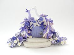 Lilac peacock wedding cake topper in polymer clay