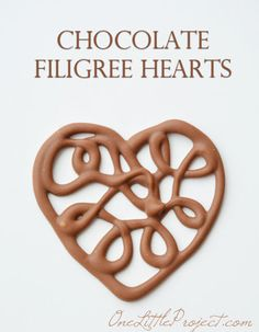 Here's+an+easy+way+to+make+chocolate+filigree+hearts.+These+would+make+the+cutest+cupcake+toppers!