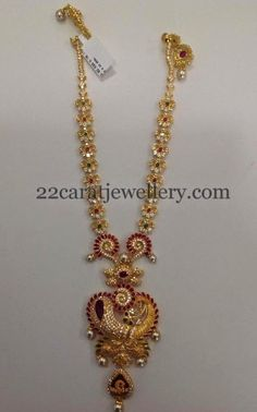 Simple flower motifs embellished antique work medium size necklace with dancing peacock embellished pendant merged in the center and look. Indian Jewellery Design, Latest Jewellery, Indian Jewelry, Jewelry Design, Gold Mangalsutra Designs, Gold Earrings Designs, Necklace Designs, Jewelry For Her, Gold Jewelry