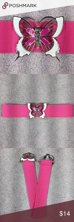 """Vintage Pink Enamel BUTTERFLY Buckle Stretch Belt Pink And White Enamel BUTTERFLY Buckle Stretch Belt. Excellent vintage condition. Pink and white enamel Butterfly interlocking buckle. Silver metal accents. Bright pink thick banded stretch belt. Belt will fit between a 23"""" to 33"""" waist comfortably. Feel free to contact me with any questions you may have about this belt. Please take a look at my other unique listings too. Thanks!! Vintage Accessories Belts"""