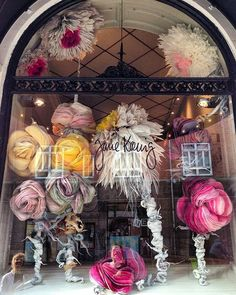 Store window display of paper flowers by Marianne Eriksen Scott-Hansen