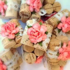 Rustic Wedding Ideas, Coral handmade flowers & lace hug three vintage wine corks for a truly unique place card display!