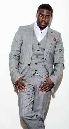 Kevin Hart in cool gray and white, touched off with a gold paisley pocket square. The belt buckle is a nice touch. He might be a mitch;  but he's all Man in this.