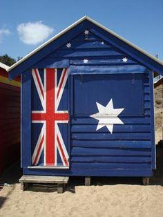 Beach shack painted with the Australian flag