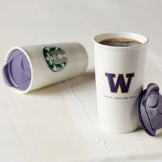 """A collectible double-walled coffee tumbler with University of Washington """"W"""" logo in purple and gold."""