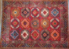This hand knotted pile tribal rug is made with all natural dyes and handspun wool. This rug was woven in a small cottage industry style weaving project. Wonderful long staple handcarded and handspun Central Asian wool is used throughout in the wool on wool construction. The unique design of this carpet is of Uzbek inspiration.