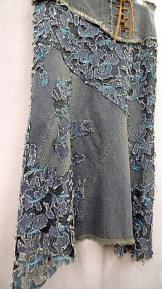 "with amazing stretch denim & net fabric applied.  lay the huge peice of fabric on one area of the skirt and started machinging, using the fabric design as a guide....before moving to the next section I trimed off the unwanted fabric.   wearable art. ""GEOLOGY urban fossil...found in the city, made with existing garments, found objects and cast-off treasures"""