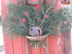 Barn door + stanchion (we have these in stock too!) + pine boughs - great holiday decor!
