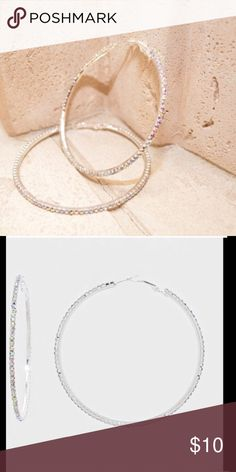 New Rhinestone Hoops Bold and beautiful hoops for the bold and beautiful woman. These are three inches in diameter. Farah Jewelry Jewelry Earrings