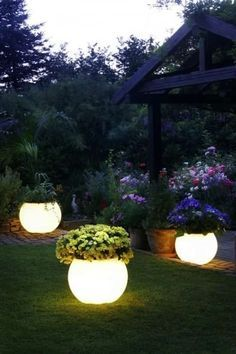 Coat planters with glow-in-the-dark paint for instant night lighting. 32 Cheap And Easy Backyard Ideas That Are BorderlineGenius by shopportunity