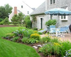 Great way to surround plain patio with a garden