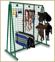free standing tack room solutions -tack on walls, this free standing in middle of tack room = double storage Dream Stables, Horse Stables, Horse Barns, Horses, Dream Barn, Horse Trailer Organization, Tack Room Organization, Tack Locker, Western Horse Tack